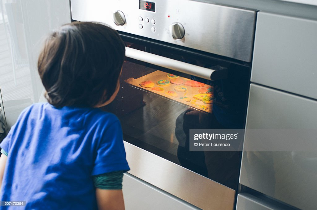 Watching biscuits cooking : Stock Photo