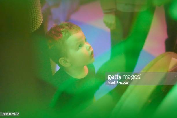 watching colourful display - museum stock photos and pictures