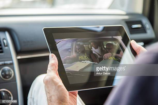 Watching downloaded American series in the car with iPad tablet