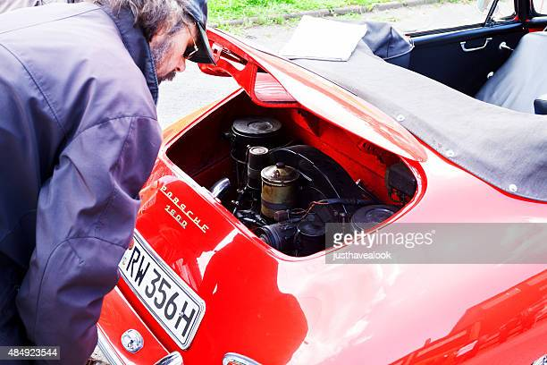 watching engine of old porsche 1600 - porsche stock pictures, royalty-free photos & images