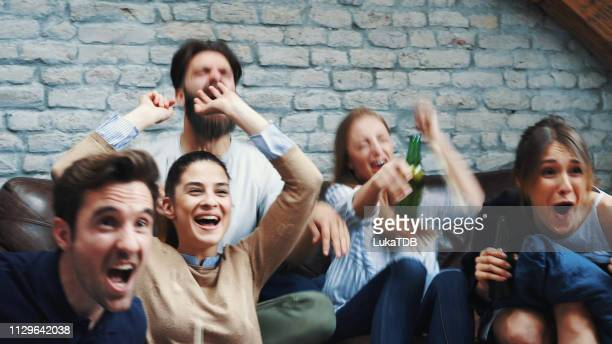 watching football world cup with friends - international soccer event stock pictures, royalty-free photos & images