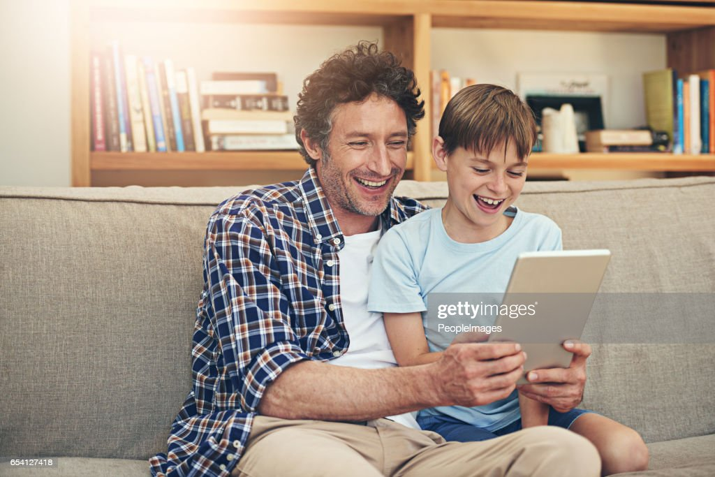 watching funny clips with dad stock photo getty images