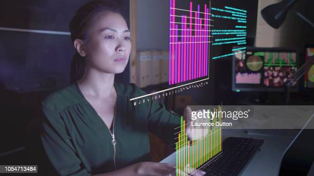 watching hologram data - hologram stock pictures, royalty-free photos & images