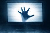 Watching horror movie on tv