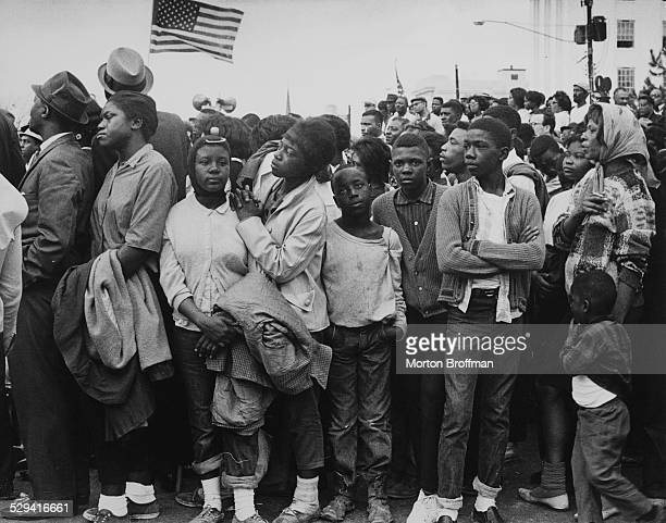 Watching marchers arrive in Montgomery Alabama March 1965