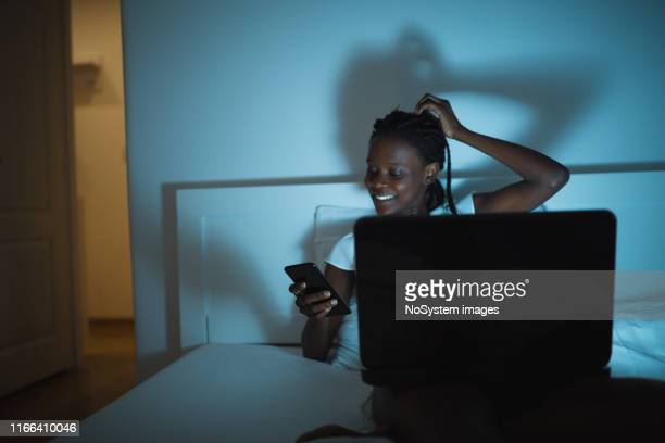 watching movie in bed - candid forum stock pictures, royalty-free photos & images