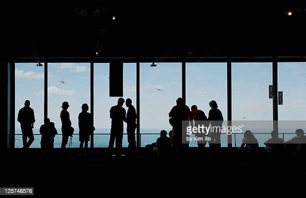 watching planes fly - ken ilio stock photos and pictures