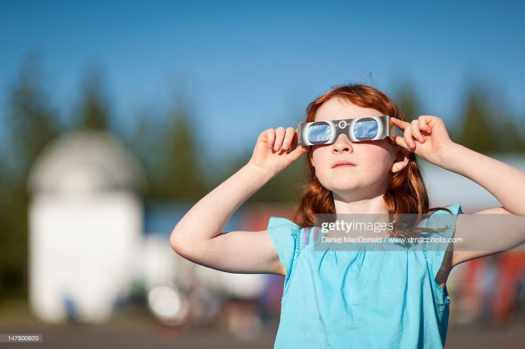 Watching solar eclipse : Stock Photo