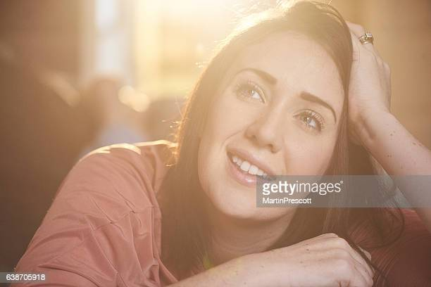 watching something funny - tv housewife stock photos and pictures