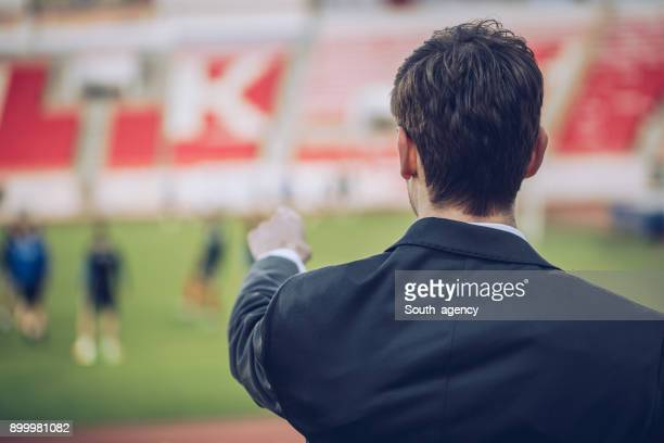 watching sports training - coach stock pictures, royalty-free photos & images