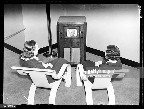 Watching television 1936 A photograph of two women watching television taken by Harold Tomlin for the Daily Herald newspaper on 2 December 1936 The...