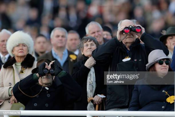 Watching the 2nd race during day four of the Cheltenham National Hunt Racing Festival at Cheltenham Racecourse on March 13th 2020 in Gloucestershire