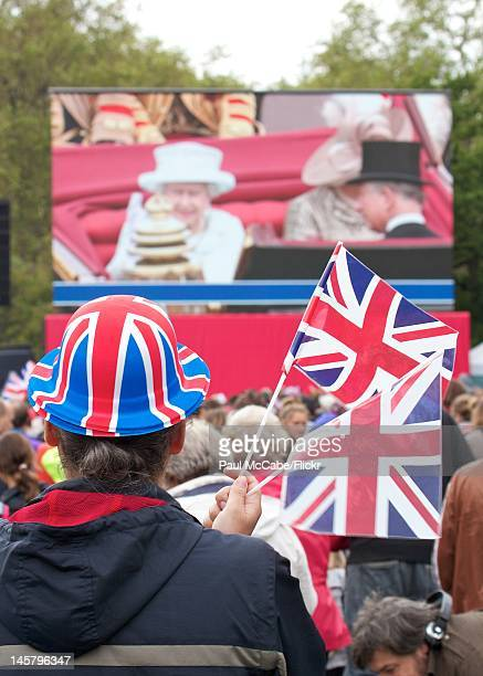 Watching the Diamond Jubilee Carriage Procession on the big screen in St James's Park, London, June 5, 2012.