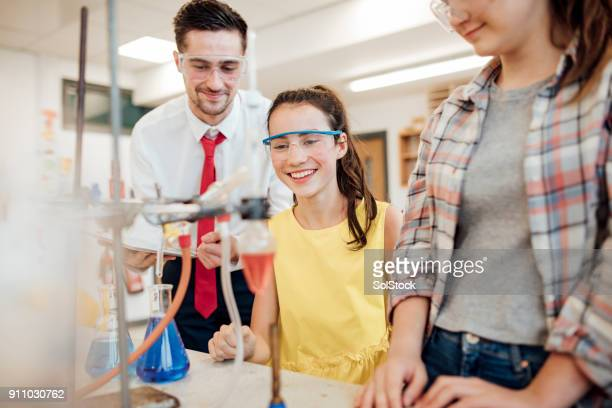 watching the experiment - educational subject stock photos and pictures