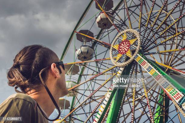 watching the ferris wheel - ipek morel stock pictures, royalty-free photos & images