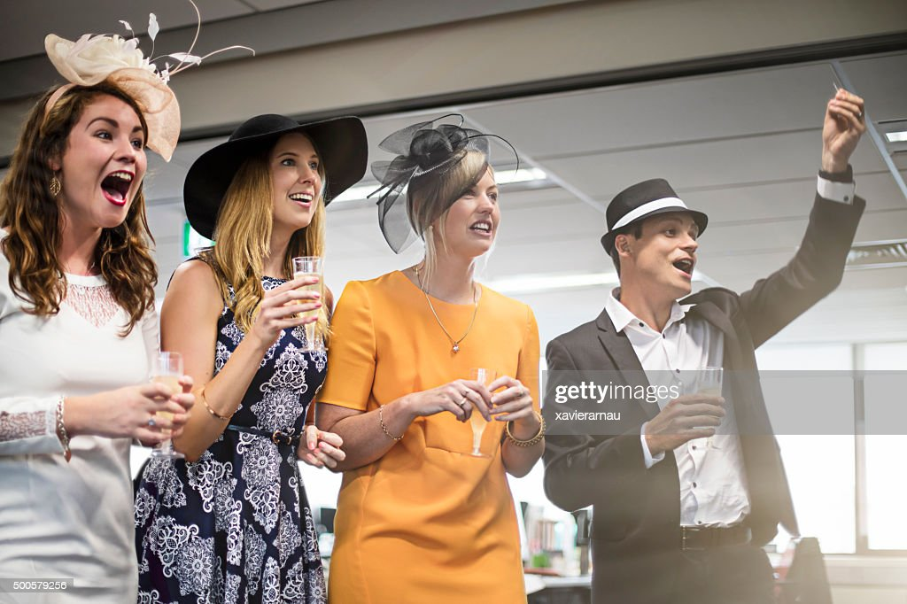 Watching the Melbourne Cup race in the offfice : Stock Photo