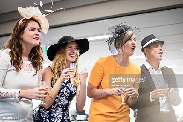 Watching the Melbourne Cup race in the offfice