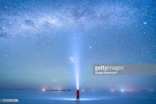 watching the milky way over the sky at uyuni salt flat, bolivia - extreme terrain stock pictures, royalty-free photos & images