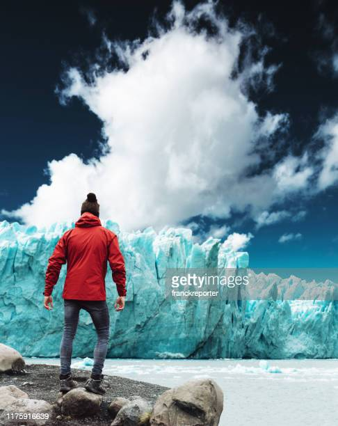 watching the perito moreno glacier in argentina - glacier collapsing stock pictures, royalty-free photos & images