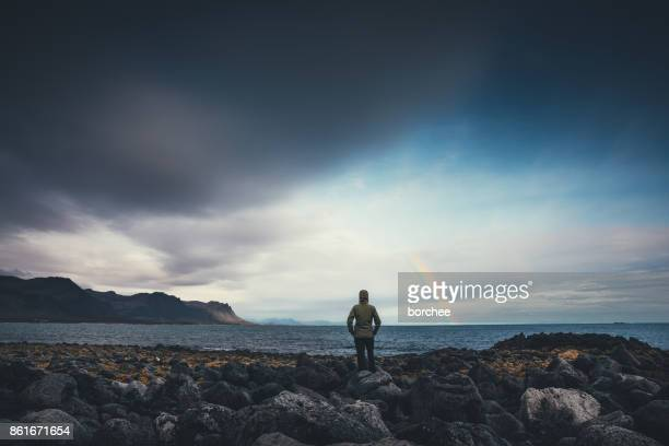 watching the rainbow in iceland - rainbow stock pictures, royalty-free photos & images