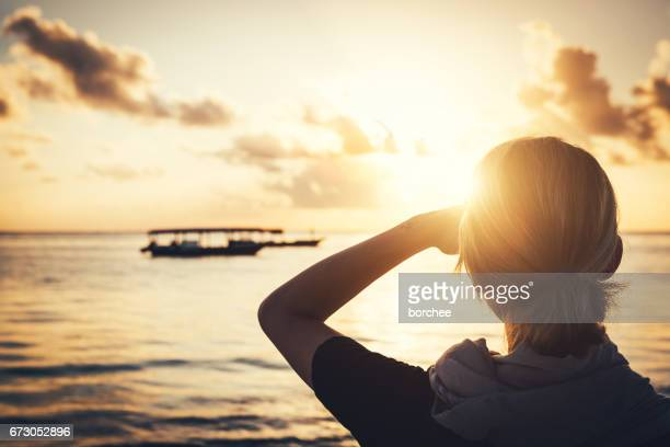 watching the sunrise - hot women on boats stock pictures, royalty-free photos & images