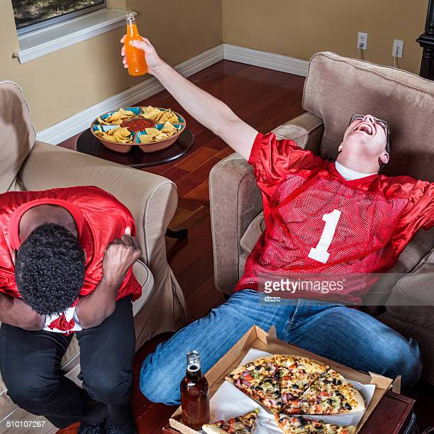 watching tv football,  ecstasy of victory and agony of defeat - fan enthusiast stock pictures, royalty-free photos & images