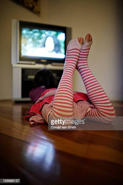 watching tv - little girls in tights stock photos and pictures