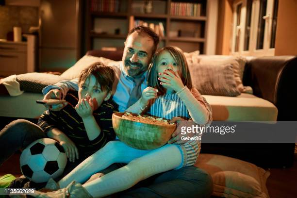 watching tv - film stock pictures, royalty-free photos & images