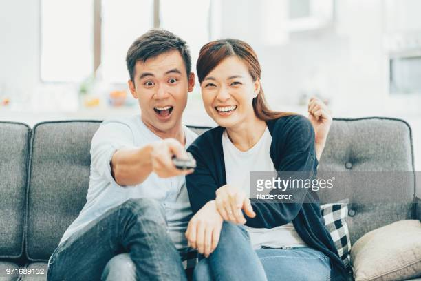 watching tv - changing channels stock photos and pictures