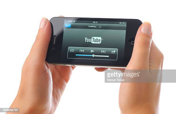 watching youtube video with iphone 4 - camera icon stock pictures, royalty-free photos & images