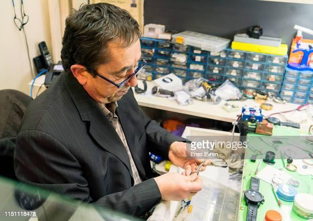 Watchmaker repairing watches
