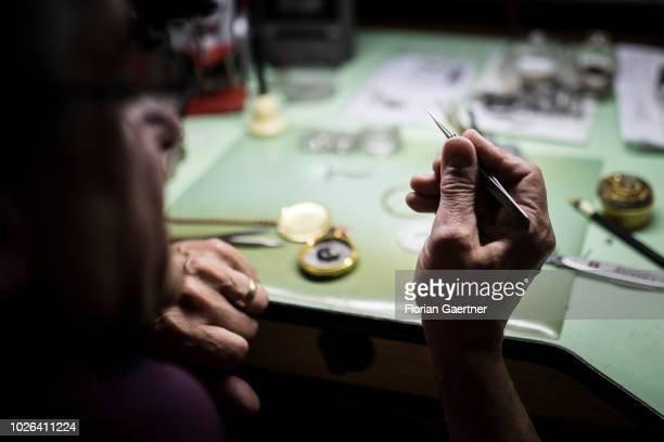 A watchmaker repairs a pocket watch in his workshop on August 16 2018 in Weisswasser Germany