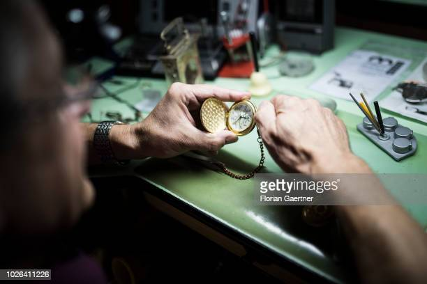 A watchmaker sets a pocket watch in his workshop on August 16 2018 in Weisswasser Germany