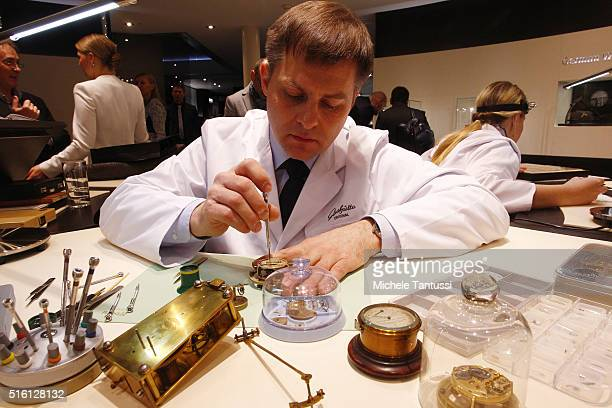 A watchmaker works on a wristwatch caliber at the Baselworld watch and jewellry Fair trade on March 17 2016 in Basel Switzerland Held annually...
