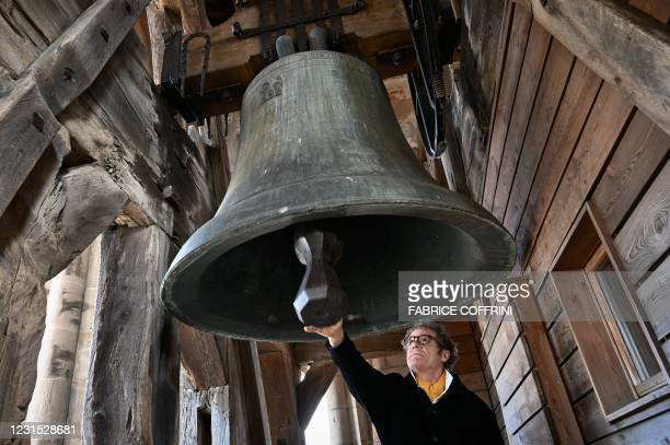 "Watchman of the Cathedral of Lausanne, Renato Haeusler manually rings the 3600 kg ""La Clemence"" emergency bell in the Cathedral's belfry tower to pay..."