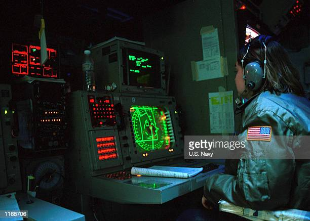 Watchstander mans her station in the Combat Information Center October 11, 2001 on board the US Navy aircraft carrier USS Carl Vinson. The Combat...