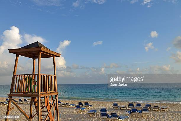 Watchtower and sunloungers on a tropical beach