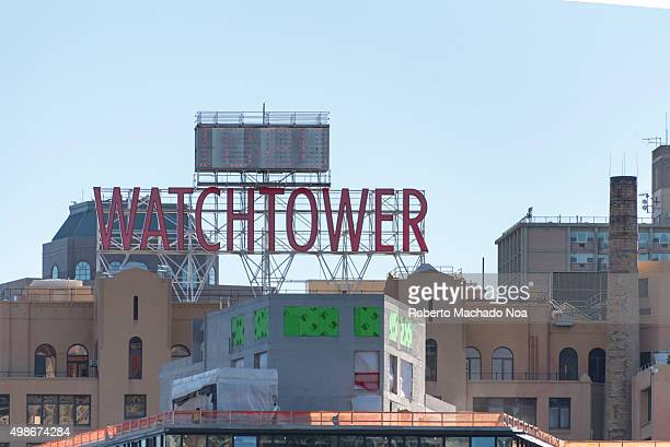 Watchtower building New York city Large digital watch and watchtower sign atop the world headquarters of Jehovahs Witnesses near Brooklyn bridge New...