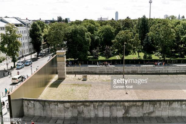 A watchtower stands in the former borderland at a memorial to the Berlin Wall in Bernauer Strasse on August 13 2019 in Berlin Germany This year in...