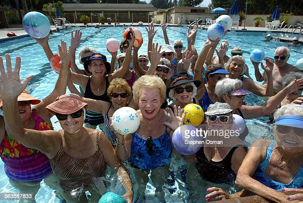 Water aerobics students demonstrate their arm stretching exercise at the Leisure Village pool in Camarillo Thursday marks the 30th anniversary of...