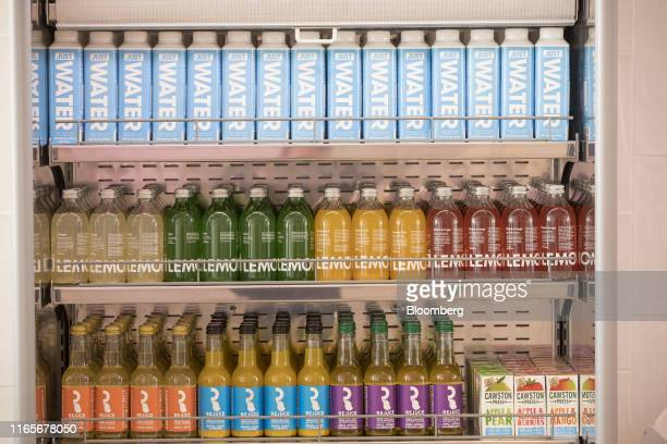 Water and fruit juice drinks sit in a fridge during the launch of the meat-free Neat Burger fast-food joint in London, U.K., on Monday, Sept. 2,...