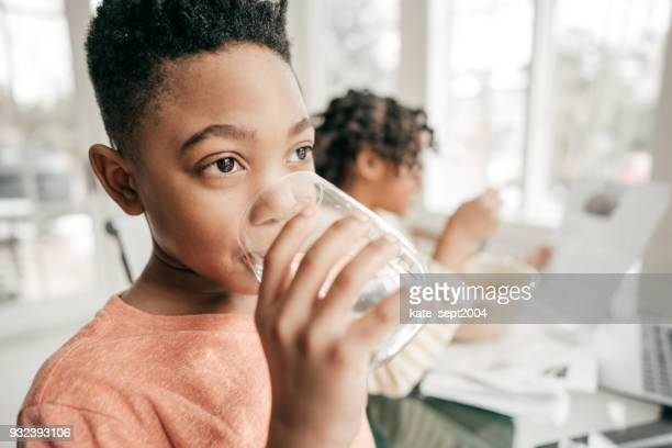 water and kids - glass of water stock pictures, royalty-free photos & images