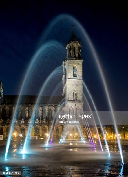 Water and light sculptures shine in the evening at the Cathedral Square in Magdeburg Germany 24 April 2013 The fountain with 66 fountain and 33 fog...