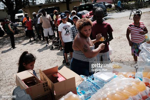 Water and other emergency items are passed out to residents in a rural migrantworker town waiting for emergency donations following Hurricane Irma on...