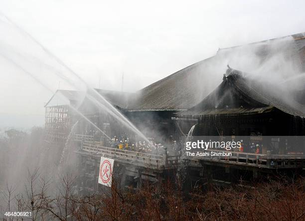 Water are discharged during the annual fire drill at Kiyomizudera Temple on January 23 2014 in Kyoto Japan