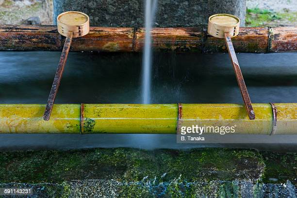 water basin at kamigamo shrine in kyoto, japan - shinto shrine stock pictures, royalty-free photos & images