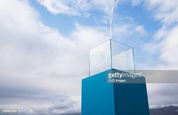 water being poured into a blue receptacle box outdoors - voetstuk stockfoto's en -beelden