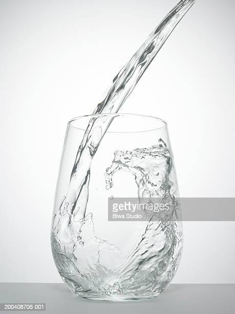 Water being poured into glass, close-up