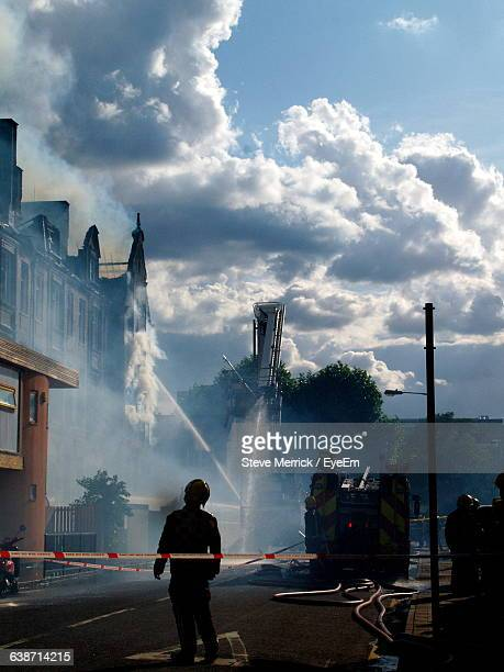 Water Being Sprayed On Building During Fire