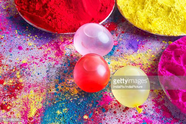 Water bombs and colorful powder during Holi festival
